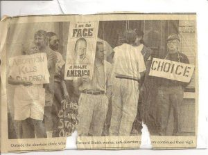 "Johanna's grandfather (holding the ""CHOICE"" sign)."
