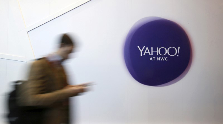 A man walks past a Yahoo logo during the Mobile World Congress in Barcelona, Spain in this February 24, 2016 file photo. REUTERS/Albert Gea/File Photo