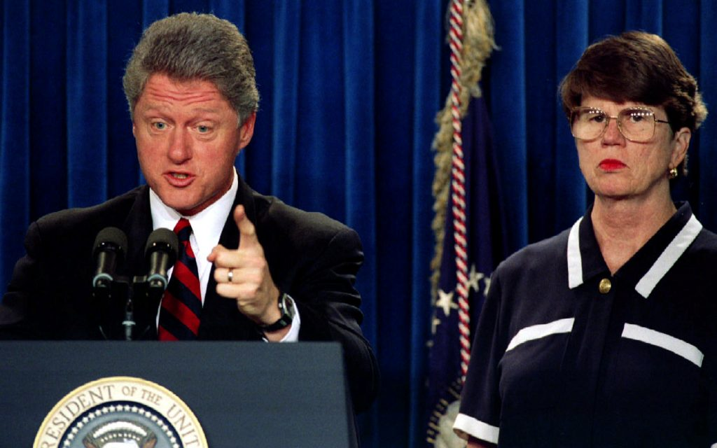 President Clinton, accompanied by Attorney General Janet Reno July 19, 1993. REUTERS/Gary Cameron/File Photo