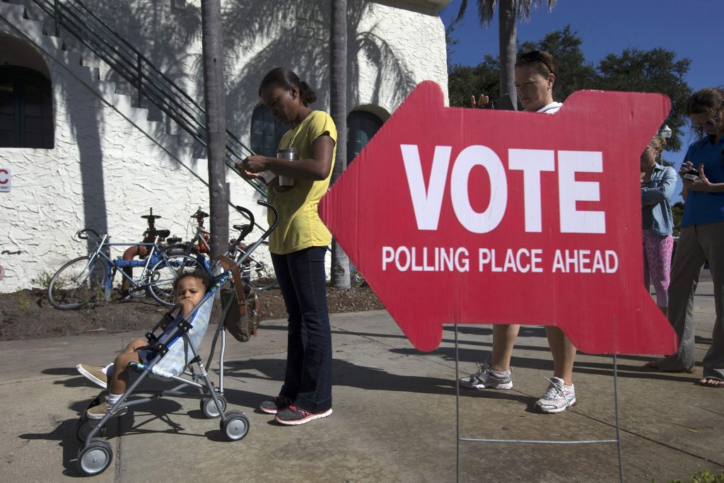 Voters head to the polls during the U.S. presidential election in St. Petersburg, Florida, U.S. November 8, 2016. REUTERS/Scott Audette